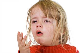 little girl with flu coughing into her hand